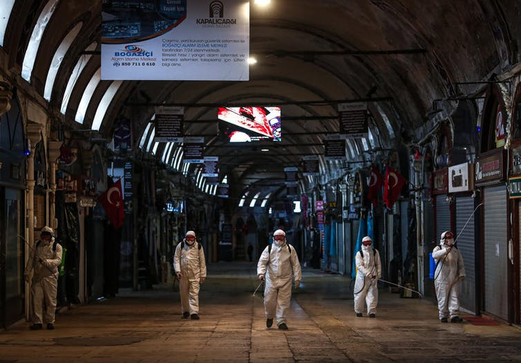 Employees disinfect Istanbul's Grand Bazaar. Sedat Suna/EPA